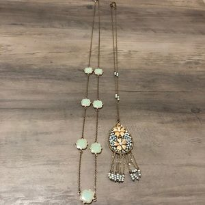 Two long and thin gold/blue necklaces